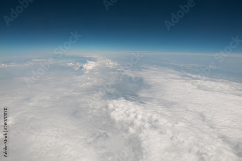 View from the airplane. Flight over the clouds - 260701170