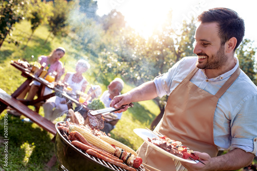 Family having a barbecue party - 260701936
