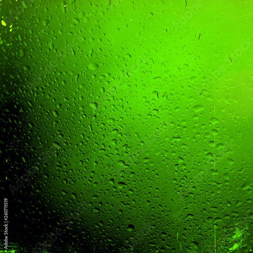 Leinwandbild Motiv Water drops on green background - Image