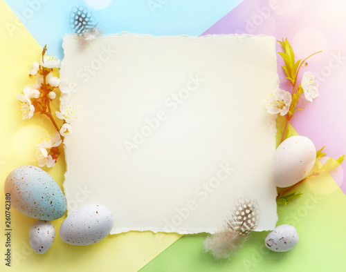 Zobacz obraz Easter background; Easter Eggs with spring Flowers on colorful Background