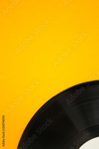 Vinyl on the yellow background, close up - 260746514