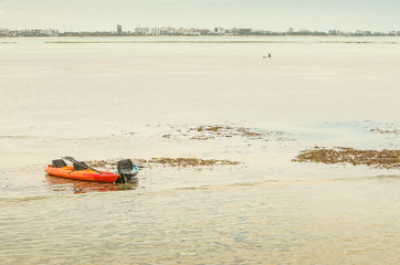 Kayaks stranded on the bancks of corals at the low tide. Caribessa, Bessa beach at Joao Pessoa PB, Brazil.