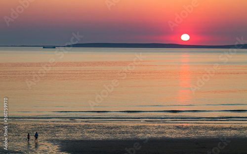 Couple walking on Quite and empty beach at sunset  on the west coast of Ireland - 260759970