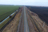 Plot railway. Top view on the rails. High-voltage power lines fo