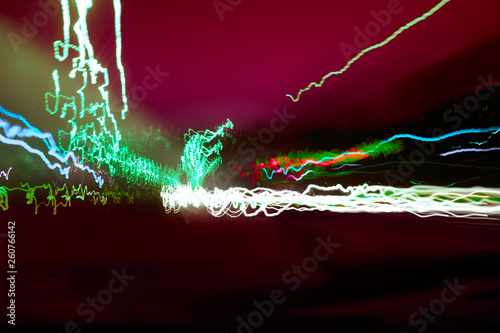 Abstract colorful neon lights at night background - 260766142
