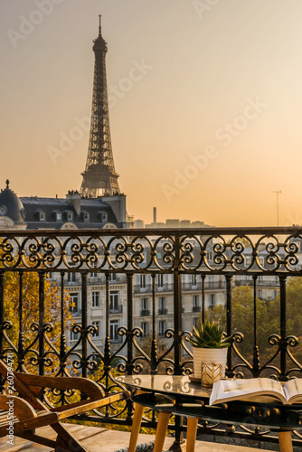 beautiful paris balcony at sunset with eiffel tower view  - 260794711