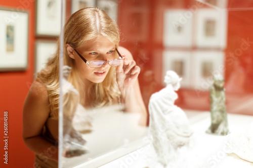 Leinwandbild Motiv Woman with glasses visiting historical museum