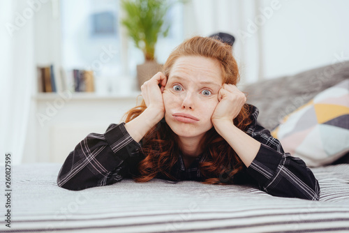 Exasperated young woman pulling a funny face © contrastwerkstatt