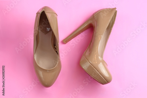 canvas print picture Trendy glamour fancy beige nude pink patent glossy pair of elegant  high heeled shoes on pink background