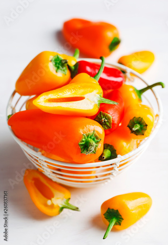 Sweet mini peppers sorted by color - 260837161