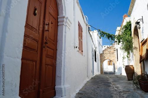 Narrow streets with white houses of Lindos, Greece.