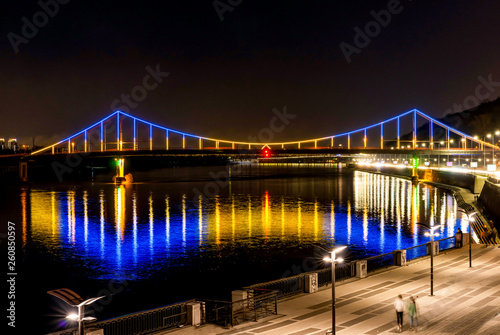 Bridge with blue and yellow light at night - 260850597