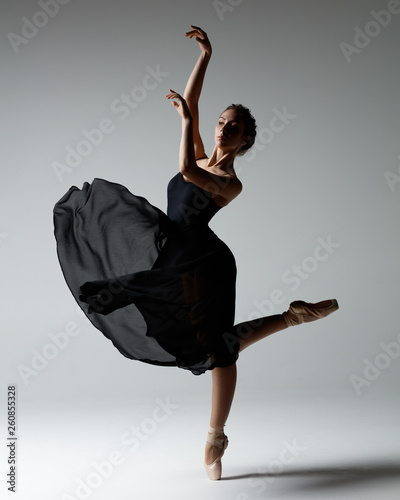 Young beautiful ballerina is posing in studio © Alexander Y