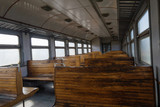 Salon electric train with empty wooden seats