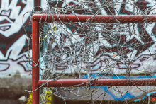 "Постер, картина, фотообои ""barbed wire fence with graffiti on the wall"""