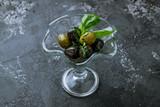 Kalamata olives on wooden table