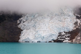 Toe of glacier at lake with heavy cloud above