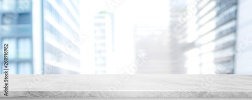 Empty white marble stone table top and blur glass window wall building banner mock up background - can used for display or montage your products. - 260916982