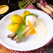 Leinwandbild Motiv asparagus with poached egg sauce and wild garlic