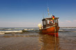 canvas print picture - Fischerboot am Strand