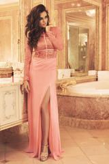 Gorgeous woman wearing beautiful dress in the luxury bathroom
