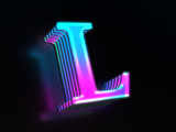 Beautiful colored glass letter L glowing in the dark