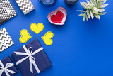 Person holding a present for Saint Valentine's day in his hands. Beautiful colorful background to st. Valentine day. Greeting card with red hearts. Wedding's invitation. Love expression.