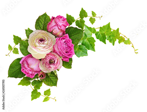 Pink roses and ranunculus flowers with ivy green leaves in a corner arrangement