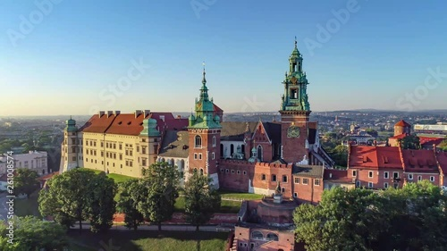 Krakow, Poland. Wawel Gothic Cathedral and belfry with the famous Sigismund Bell (Dzwon Zygmunta) at renaissance castle. Aerial 4K approaching/revealing video in sunrise light