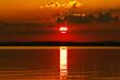canvas print picture - Paddeln durch den Sonnenuntergang
