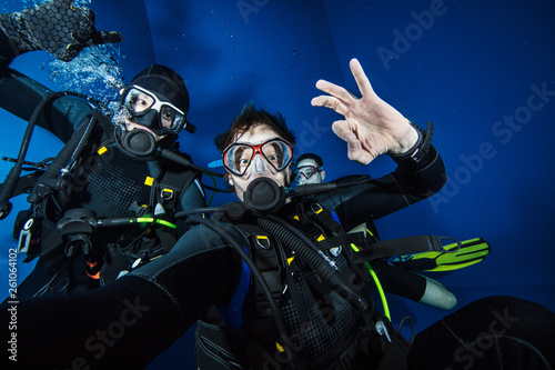 Young men scuba divers making selfie.