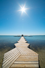 Wooden pier in the Lesser Sea for light boats in Murcia, Spain