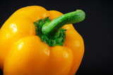 Yellow bell pepper on a dark background.