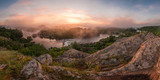 Panorama with bank of river in morning fog