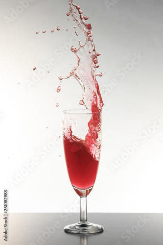 canvas print picture Splash rot mit Sektglas 1