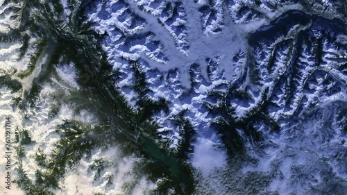 Satellite aerial view of mountains with snow Mehatl Creek Park in British Columbia, Canada, night to day sunrise animation. Contains public domain image by Nasa