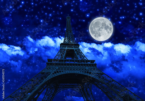 night sky with clouds and big full moon at night with backlit Eiffel Tower. Paris in France. - 261154575