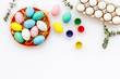 eggs with colorful paint for easter tradition on white background top view mockup