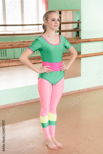 canvas print picture A girl practices yoga in a gym and smiles