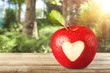 Leinwanddruck Bild - Red apple with a heart shaped