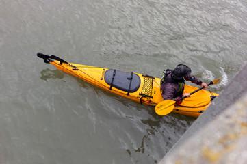 kayak on the bay under pier