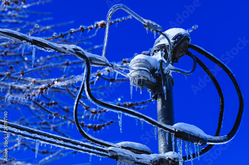electrical box installation with crystal icicles hanging from the wires   weather winter disaster in north