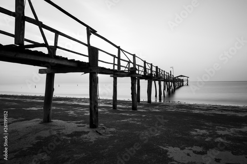 Abstract Old wooden jetty pier long exposure during beautiful sunset © alenthien