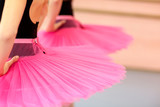 Two ballet dancers standing, focus is on costume