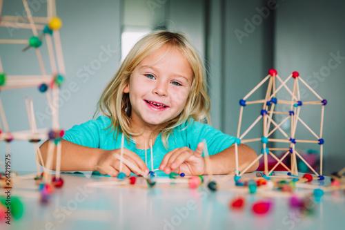 Leinwandbild Motiv happy child making geometric shapes, engineering and STEM