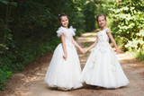 happy beautiful girls with white wedding dresses