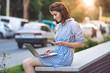 Leinwandbild Motiv brunette girl with phone and laptop