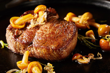 Gourmet wild venison steak with mushrooms