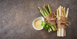 Leinwandbild Motiv Two bundles of fresh raw green and white asparagus