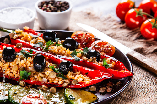 Pepper stuffed with groats and vegetables - 261298730